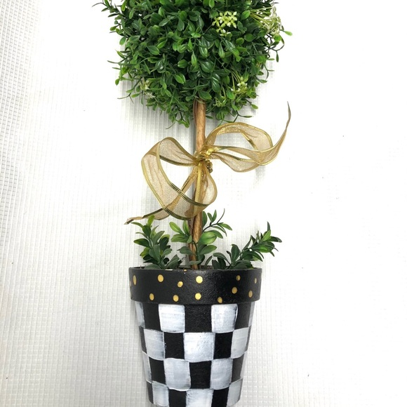 Topiary in painted pot